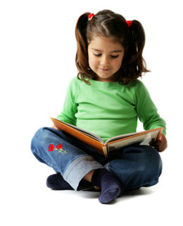 young girl sitting cross-legged reading